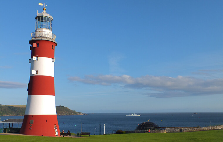 Red and white striped lighthouse known as Plymouth Hoe