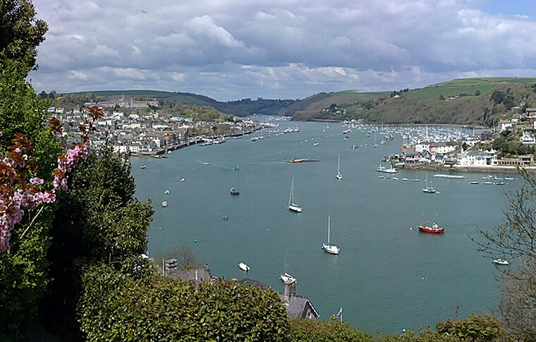 Overview of the Dartmouth Harbour with sailboats floating on the water